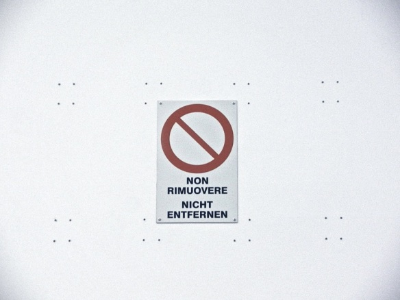 Wall plugs, readymade 'Do Not Remove' sign, wall